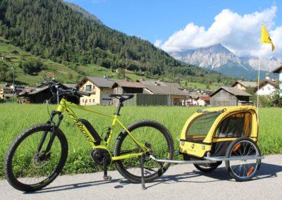 noleggio bici con carrellino porta bambini Cicli Bettega Primiero